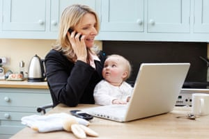 A woman working at home with a baby