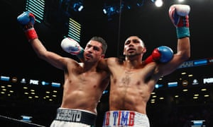 Keith Thurman (right) and Josesito Lopez embrace after their WBA welterweight title fight