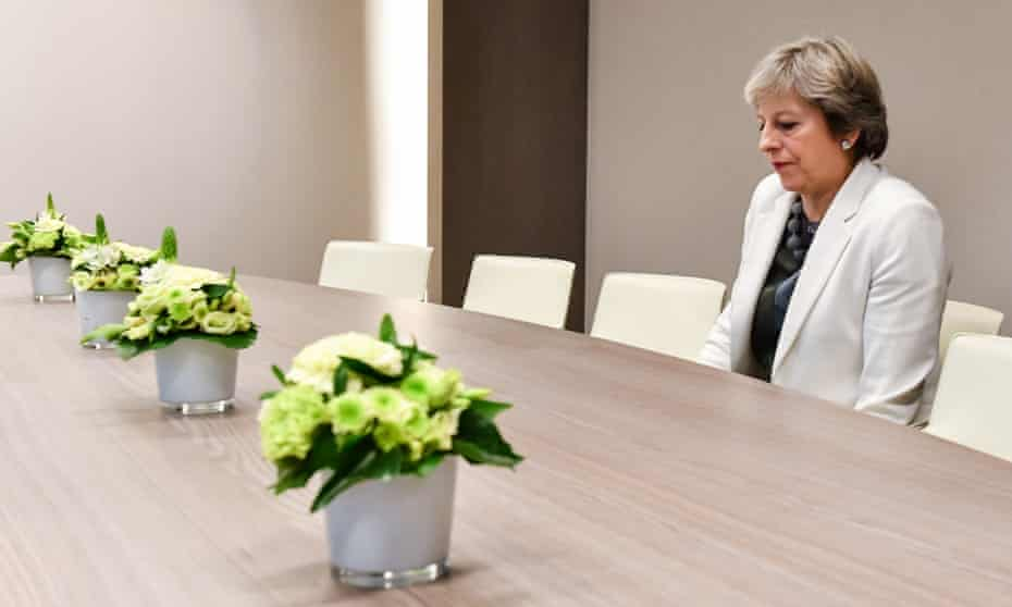May takes a seat as she arrives for a bilateral meeting with European council president Donald Tusk on 20 October 2017.