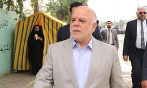 The Iraqi prime minister, Haider al-Abadi, arrives to cast his vote at a polling station on Saturday.