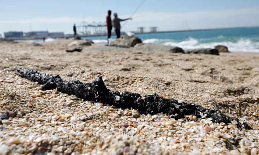 A clump of tar on a beach in Ashod, Israel