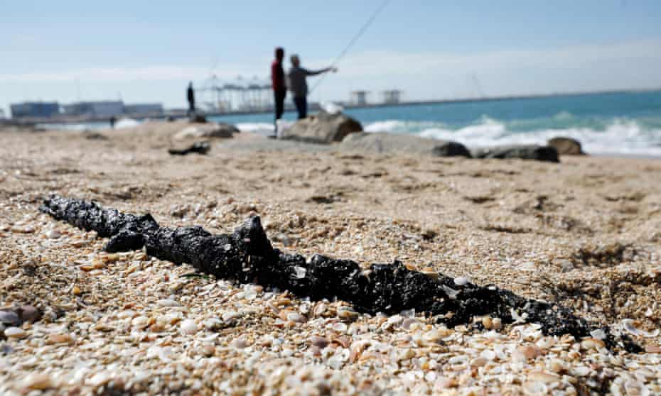 A clump of tar is seen on the sand at Ashdod, southern Israel