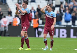 Decalan Rice and Aaron Cresswell applaud the fans after their 2-0 win over Manchester United.