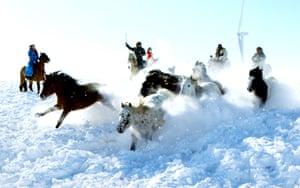 Xilingol herdsmen tame horses on the snow-covered grasslands of Inner Mongolia, China