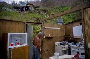 Morovis, Puerto Rico. A man walks into his sister's house destroyed by Hurricane Maria, in the San Lorenzo neighbourhood