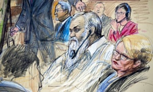 A courtroom sketch shows Ahmed Abu Khattala listening to a interpreter during his trial.