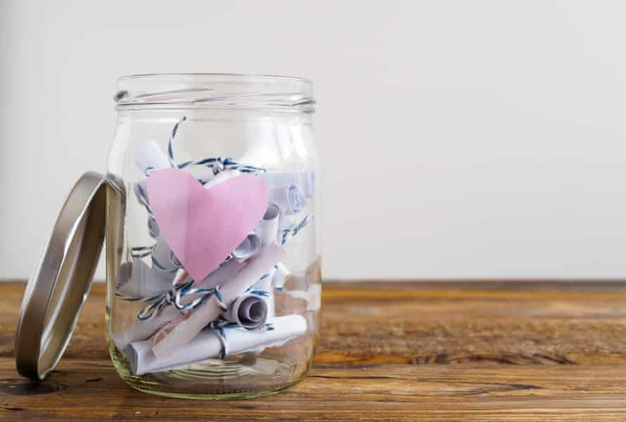 A jar with rolled paper notes.