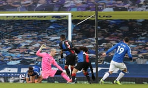 James Rodriguez of Everton scores their team's first goal past Patrick van Aanholt of Crystal Palace.