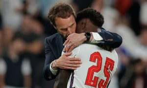 England manager Gareth Southgate consoles Bukayo Saka.