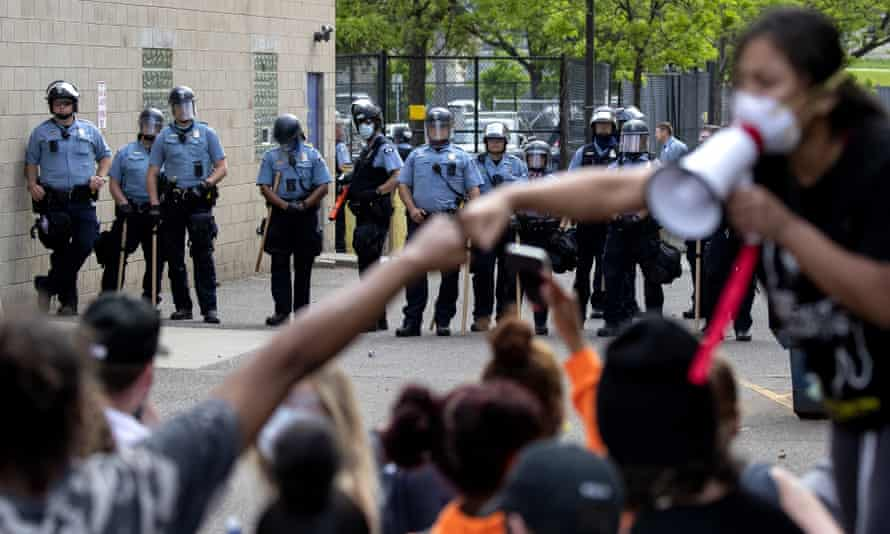 People gather in front of the Minneapolis police as they protest against the death of George Floyd on 27 May.