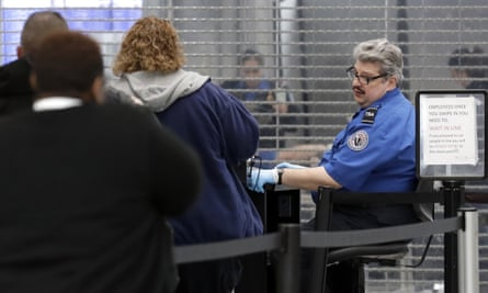 TSA officers work at a checkpoint at O'Hare airport in Chicago on Friday.