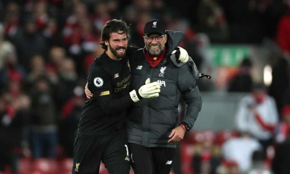 Man of the people: Jurgen Klopp with goalkeeper Alisson after the West Ham game last month.