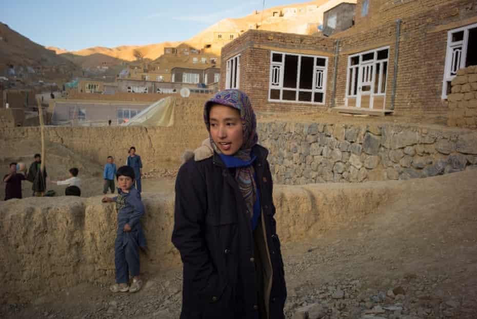 Najiye Mohammadi, 17, walks through her neighbourhood in Bamyan a few days before competing in the Afghan Mountain Challenge.