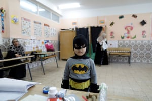 A boy in a Batman costume stands in a polling station during the parliamentary election in Algiers, Algeria, on 4 May