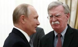 John Bolton (R) meets Vladimir Putin in the Kremlin