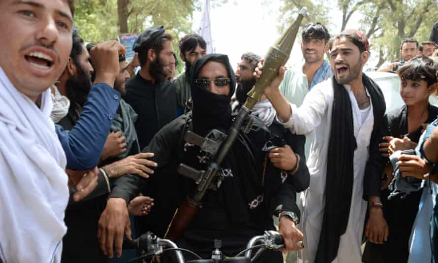 A Taliban militant among residents in Jalalabad during the ceasefire