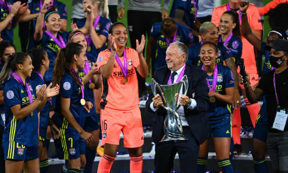 Lyon president Jean-Michel Aulas celebrates with the team after they beat Wolfsburg in the Champions League final in August.