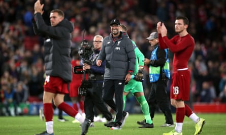 Jürgen Klopp (centre) leaves the pitch with his players.
