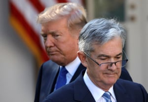 He's behind you.... Donald Trump has claimed Federal Reserve chair Jerome Powell is 'clueless' for not cutting interest rates faster