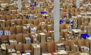 Workers surrounded by boxes in a warehouse