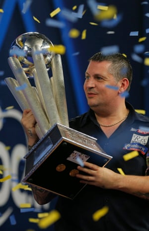 Gary Anderson lifts the Sid Waddell trophy.