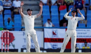 England's Ben Stokes and Joe Root and react as Anderson goes close.