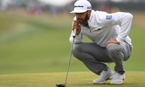 Dustin Johnson lines up a putt on the first green during the second round at Shinnecock Hills.