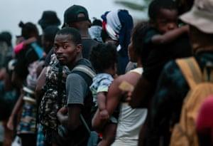 Man in queue looks back