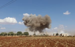 Smoke billows following Syrian government forces' bombardment around the village of al-Muntar on the southern edges of the rebel-held Idlib province.