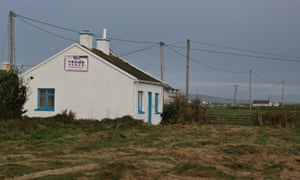 A house next to the golf course sports an election poster supporting Donald Trump, as well as Mike Pence, who has family in the Doonbeg area.