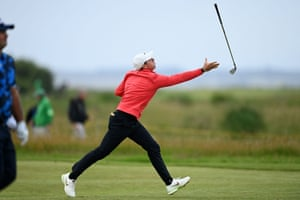 Rory McIlroy fails to catch his club after tossing it in the air.