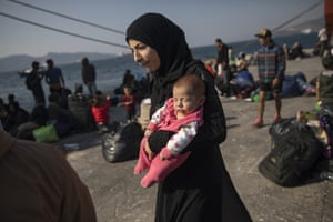 Elefsina, Greece16 year-old Montaha from Aleppo, Syria, walks with her two months daughter Batour after their arrival at the port near Athens. About 700 refugees and migrants arrived from Samos island as authorities have been moving hundreds of migrants deemed to be vulnerable from the overcrowded Samos camp to camps on the mainland