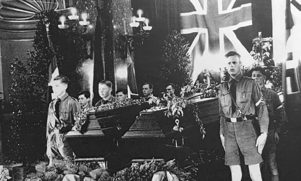 Members of the Hitler Youth stand guard over the coffins of five English schoolboys, who died on a hike in the Black Forest in 1936.