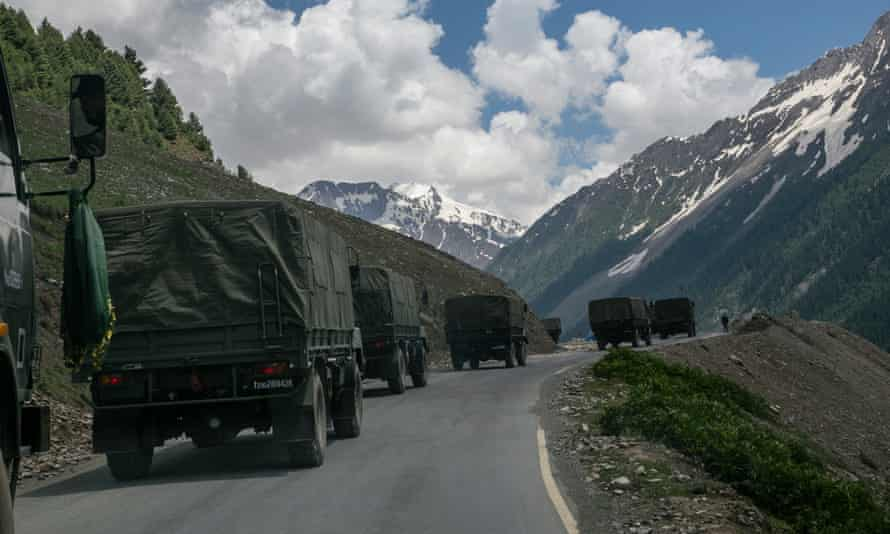 An Indian army convoy, carrying reinforcements and supplies, travels along a mountain pass bordering China in Ladakh, India.