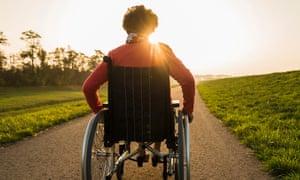 A woman in a wheelchair in a park
