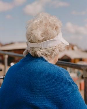 White visor, blue jumper. Bridlington, Yorkshire.