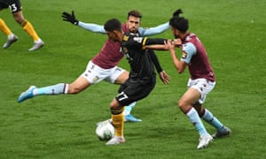 Chem Campbell holds off Aston Villa's Neil Taylor during Wolves' defeat.