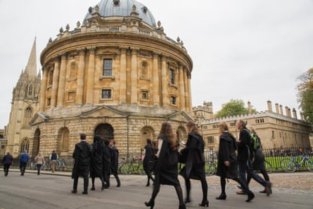 Oxford students pass the Radcliffe Camera on their way to matriculation.