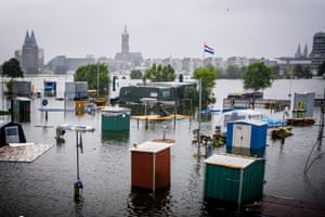 Roermond, The Netherlands: The Maas rises to a record height and floods campers at De Hatenboer.