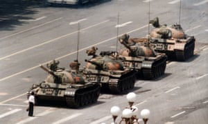 A Chinese man stands alone in 1989 to block a line of tanks heading east in Tiananmen Square in protest against violence against pro-democracy demonstrators