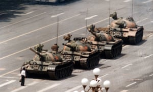A Chinese man stands alone to block a line of tanks in Tiananmen Square, 1989.