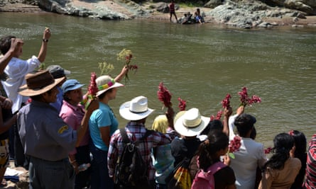 People honour the late assassinated environmentalist Berta Cáceres with a religious ceremony on the Gualcarque River near Tegucigalpa in 2016.