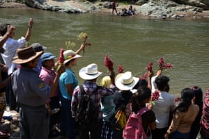 People honuor the late assassinated environmentalist Berta Cáceres with a religious ceremony on the Gualcarque River, Hondurans.