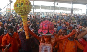 Supporters of Bharatiya Janata Party (BJP) attend a public rally being addressed by Indian Prime Minister Narendra Modi (not pictured) during the ongoing fourth phase of the West Bengal's state legislative assembly elections, at Kawakhali on the outskirts of Siliguri on 10 April, 2021.