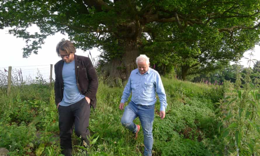 Dan Llywelyn Hall (left), who is leading the campaign to save Offa's Dyke walks the earthwork with 'tree hunter' Rob McBride.