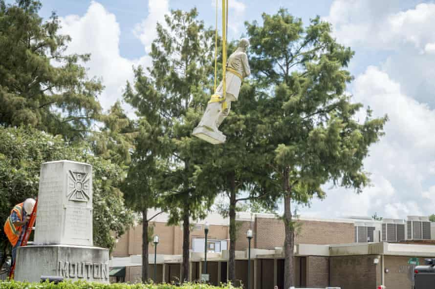 The statue of Confederate Gen Alfred Mouton is removed on Saturday.