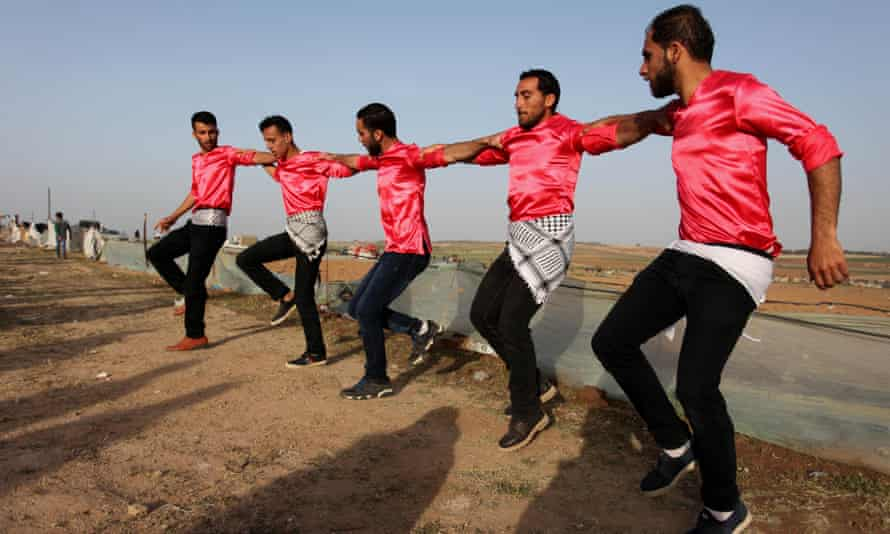 A Palestinian dabka band perform during the protest.