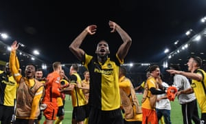 Winning goalscorer Jordy Siebatcheu celebrates with his teammates after Young Boys' victory.
