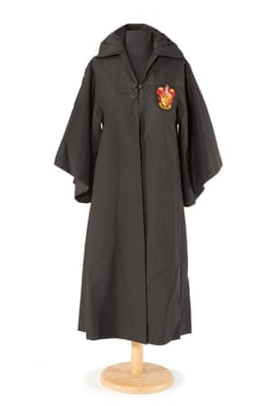 A Hogwarts school robe with Gryffindor house crest worn by Daniel Radcliffe in Harry Potter and the Sorcerer's Stone (2001). Williams was eager to play Hagrid in the films, but fell foul of JK Rowling's Brits-only decree