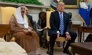 Donald Trump speaks as he meets with the emir of Kuwait, Jaber al-Ahmad al-Sabah, in the Oval Office of the White House in Washington DC.